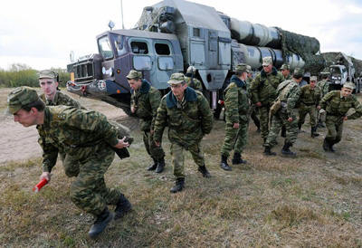 Russia drew praise from the U.S. for not selling Iran an air defense system such as the S-300, used in a joint exercise in Belarus. (Viktor Drachev, AFP/Getty Images / September 21, 2010)