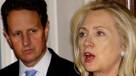 Getty Images: US Secretary of State Hillary Clinton (R) and US Secretary of Treasury Tim Geithner (L) deliver remarks in the Treaty Room of the US Department of State on measures to increase pressure on Iran, November 21, 2011 in Washington, DC.