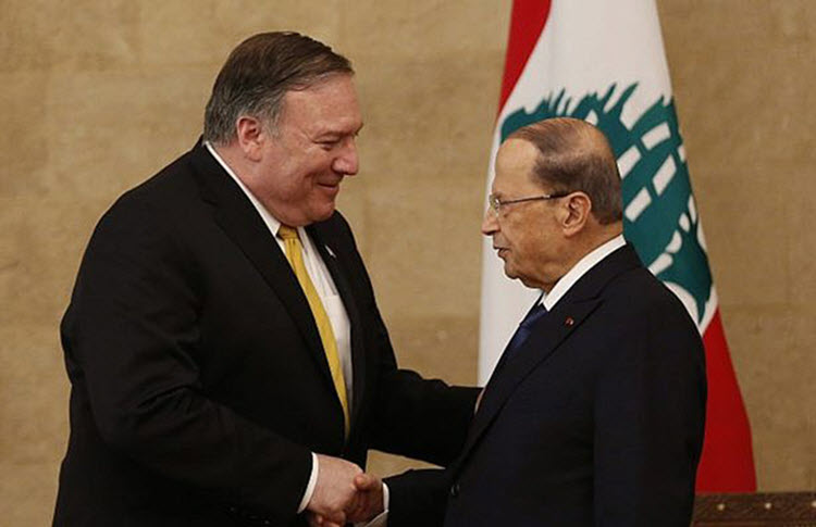 US Secretary of State Mike Pompeo, left, shakes hands with Lebanese President Michel Aoun