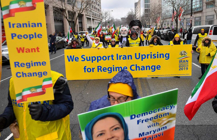 Demonstrations participate in a rally held by the Organization of Iranian-American Communities in support of a regime change in Iran, in Washington, D.C
