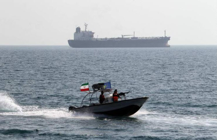 A picture of a radar boat of the Revolutionary Guard and a tanker vessel in the Strait of Hormuz