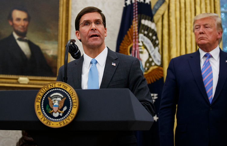 President Donald Trump looks to Secretary of Defense Mark Esper during a ceremony in the Oval Office at the White House