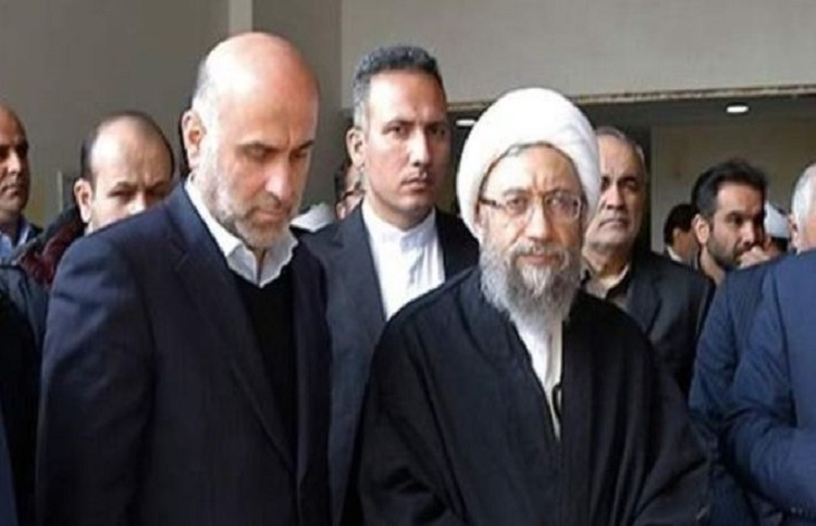 Akbar Tabari (left) and the former head of the Judiciary of Iran Sadeq Ardeshir Larijani (right).