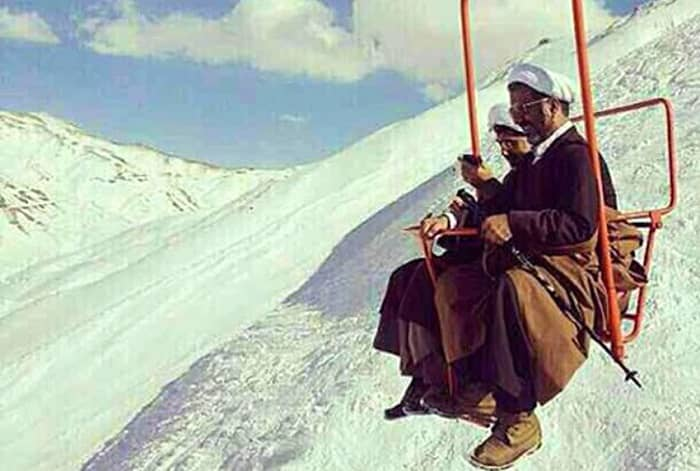 Two of Iran's clerics take a ski-lift after a mountain walk