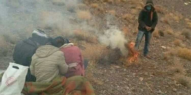 Iranian students must gather around the fire to receive education due to the lack of educational infrastructures.