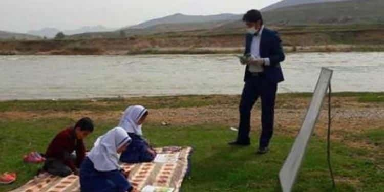 Iranian teachers have to hold their classrooms in pastures because of the lack of proper educational facilities.